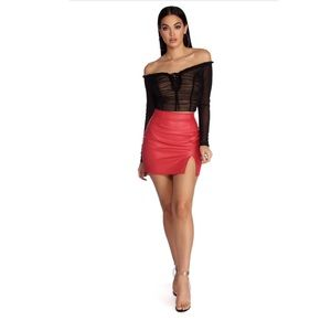 Red high rise waist, faux leather skirt.